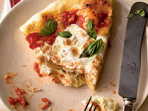 "Because this Neapolitan-style pizza is so simple, it depends on quality ingredients: Use the best fresh mozzarella and basil you can find. ""Classic and delicious, plus the dough is a dream to work with,"" says recipe tester and developer Deb Wise."