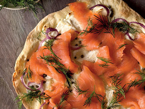 The crisp cracker crust of this pizza makes a pleasing contrast to the velvety soft salmon.