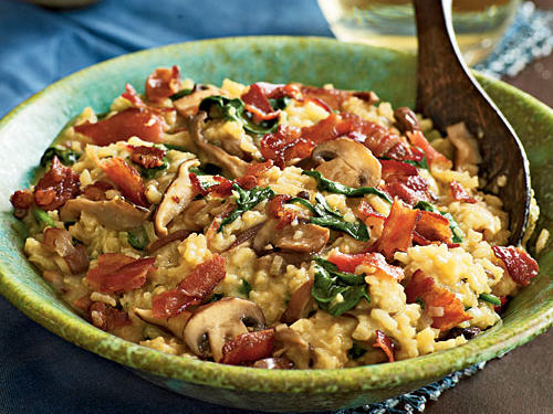 "Crisp bacon brings crunchy texture and smoky flavor to this creamy, cheesy risotto dish. Associate food editor, Tim Cebula, raves, ""Bacon and risotto: can't go wrong."""