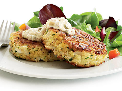 Our version of crab cakes is ideal for the season: a ­vibrant and light dish that pairs perfectly with a crisp salad and glass of wine. We lightly season sweet, premium crab and use just enough mayonnaise, low-sodium panko (Japanese breadcrumbs), and egg to bind it all together. We don't add any salt to the mixture, to keep sodium in check. The cakes are cooked in a slick of oil instead of deep-fried. We love a good rémoulade but overhaul the condiment to add a flavor punch without as much sodium.