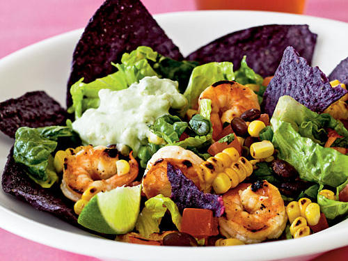 Cilantro, chipotle hot sauce, corn, black beans, and green onion lend fantastic south-of-the-border flavor to this shrimp-topped taco salad.