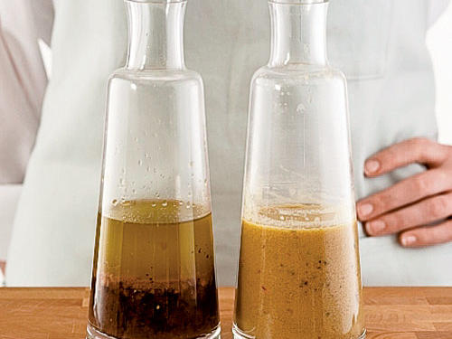 When properly emulsified, ingredients are suspended throughout the mix (right). A broken vinaigrette (left) will have clear separation between the oil and vinegar. Store fresh-made vinaigrette in a covered container in the fridge for 3 to 4 days. Whisk before serving.