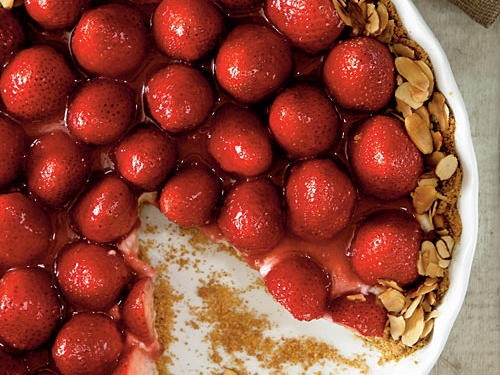 Nestled in a creamy filling and crumbly graham cracker crust, strawberries shine in this delectable tart.
