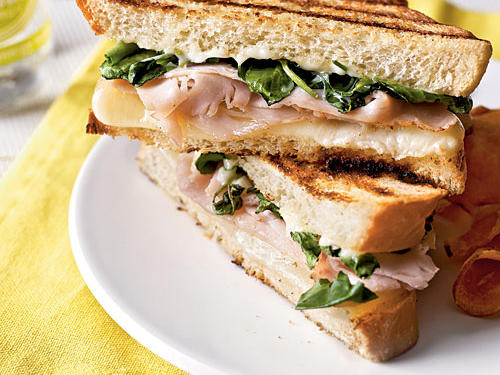 Gooey provolone, white bread with a crunch, and refreshing citrus aioli--all in a turkey and watercress panini--make a mouth-watering combination. This hearty sandwich will not leave you with hunger pains, but it might just leave you wishing for one more bite.