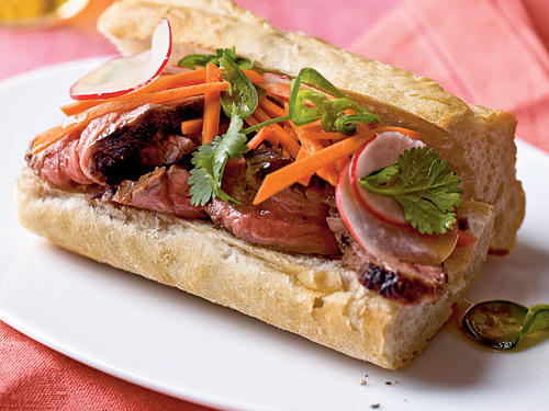 Fresh veggies coated in traditional Vietnamese flavors give this roast beef sandwich crunch. The signature crusty baguette that envelopes the filling offers the perfect contrast in texture.
