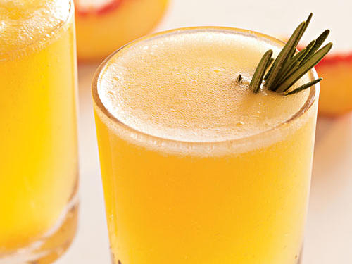 A heady punch of woodsy rosemary creates an herbaceous riff on the classic Bellini.