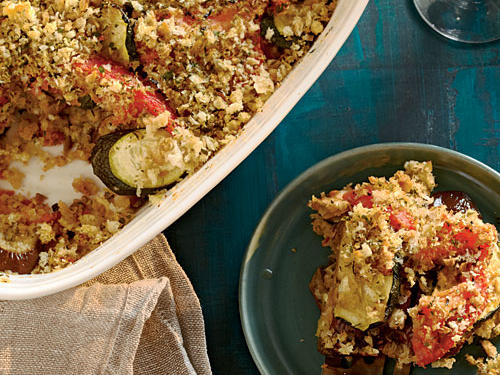 Don't push the veggies to the side! Put them center stage, like in our satisfying Eggplant, Zucchini, and Tomato Tian. Fresh summer squash, eggplant, and tomatoes are the stars in this recipe.  A crunchy, salty, breadcrumb coating atop layers of eggplant, zucchini, and tomato give the fresh ingredients the ideal complement. An 11 x 7-inch glass or ceramic baking dish works well for this recipe, but if you have a 2-quart tian or gatin dish, all the better.