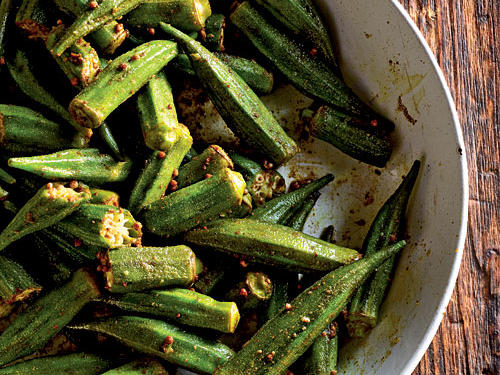 Even folks who usually don't like okra enjoy the taste and texture of this highly seasoned dish. We left the seeds in the chile for moderate spice. Serve with grilled chicken or lamb.