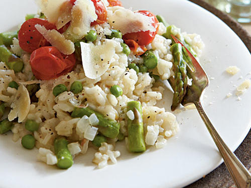 This risotto is studded with the color and vibrant flavor of fresh veggies. Although inexpensive, this dish is attractive and tasty enough to serve guests.