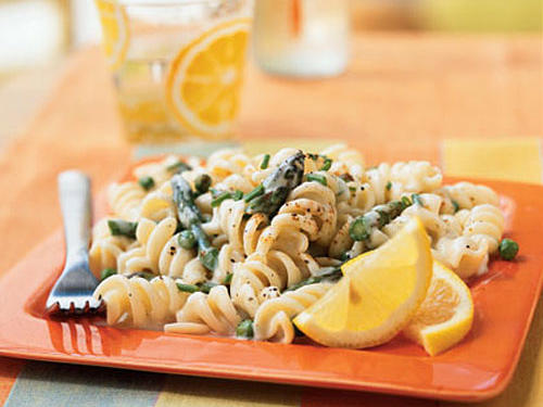 Citrus flavors and fresh vegetables brighten this meatless pasta recipe. Leftovers pack nicely for work or school.