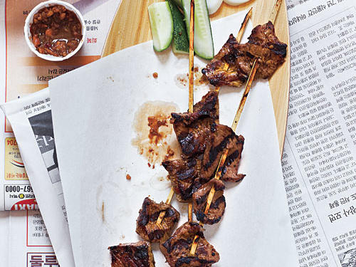 This all-time favorite is part of Singapore's Malay culinary tradition. Here we use beef, but chicken, pork, and lamb are also popular. Satay is usually served with wedges of cucumber and raw onions. Substitute fresh gingerroot for galangal, if you can't find it.