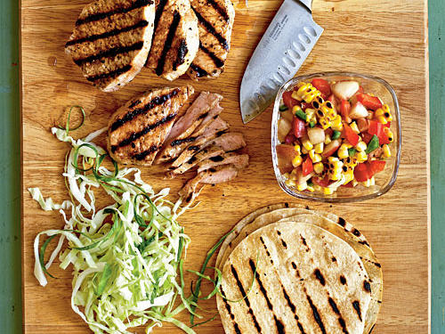 Embrace the warm summer weather and flavors by grilling the pork for these tacos, then adding a summer corn and nectarine salsa to the mix. Be sure to zest your lime before you slice and juice it.