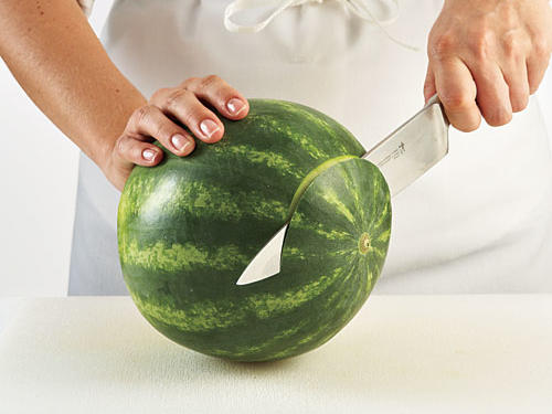 Stand your melon up: It's much easierStep 1: Place washed melon on a cutting board, and use a sharp, heavy knife to slice about one inch from the stem end to make a stable cutting surface.Tip: Always rinse a melon before slicing. Melons are grown in dirt and frequently handled: They may look clean but can harbor bacteria on the skin—especially netted varieties like cantaloupe. Thoroughly rinse so you don't transfer bacteria to fruit when cutting.
