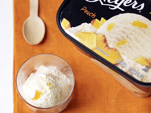Swirling chunks of sweet fresh peaches into a creamy regular ice cream is one way to capture some of the best flavors of summer. Turns out it also helps lighten the fat and calorie load just enough that this regular scoop from Breyers® easily meets our guidelines for light. All we can say is peachy keen.Frozen assets per ½ cup: 120 calories, 4.5g fat, 3g sat fat, 16g sugars