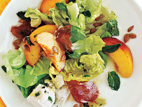 Serve this light main-course salad with a hunk of crusty baguette and a glass of chilled Riesling. Choose ripe, juicy peaches, and leave the peel on for more texture. Ricotta salata is a milky, mild, slightly salty cheese that's easy to crumble; you can substitute feta or goat cheese.