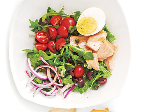 The bold flavors of red onion, piquant capers and kalamata olives, and peppery arugula elevate hum-drum tuna salad to new heights. If your budget allows, try a premium jarred tuna, like Ortiz, which is rich, firm, and meaty. And purchase precooked, peeled eggs from your supermarket. You can also substitute arugula with baby spinach.