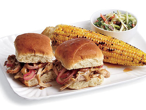 Kick things off with a barbecue sliders, grilled corn, and broccoli slaw. Shredded, grilled chicken thighs are dipped in Carolina-style barbecue sauce, a vinegar-based mix with mustard, a little honey, seasonings, and butter. Sides of grilled corn with honey butter (that complement the BBQ sauce perfectly) and creamy broccoli slaw round out the meal.Get everyone involved with throwing dinner together. One person can shuck the corn and mix the slaw, another can man the grill, and another can assemble the sliders. Who's on cleanup duty? We suggest you draw straws for that one.View Recipes: Barbecue Chicken Sliders with Pickled Onions  Broccoli SlawGrilled Corn with Honey Butter