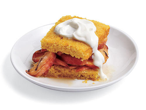 "Brandied Peach Shortcakes make good use of your made-ahead Citrus Shortcake and an ""airline"" bottle of brandy. Peaches are seared on the grill and then drenched in a brandy-honey butter sauce. Sounds like a  sweet start to a weekend of fun."