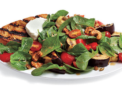 Fire up the grill and get that toasty bread smell wafting on the breeze. A light lunch is on the way. The make-ahead nut snack mix adds crunch and heat to the salad, pleasant foils to creamy goat cheese and sweet bell pepper. After grilling the veggies, reserve 2 bell pepper wedges and 2 eggplant slices for Sunday's hash.
