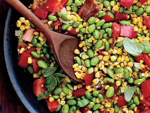 Edamame, with its sweet taste and crunch, is a surprising kid favorite. It makes a hearty addition to this summer staple. If you can't find frozen, shelled edamame (green soybeans), substitute the more traditional lima beans. Let the kids pick and choose what goes in this dish. They don't like onions? Leave them out. Teenager going vegetarian? Leave out the bacon. If they make some of the decisions they're more likely to eat it.