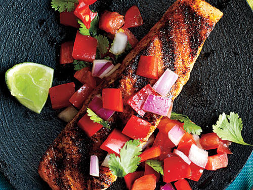 This grilled salmon recipe pairs rich fish with bright flavors. While the fish cooks, prepare the easy red pepper and tomato salsa.
