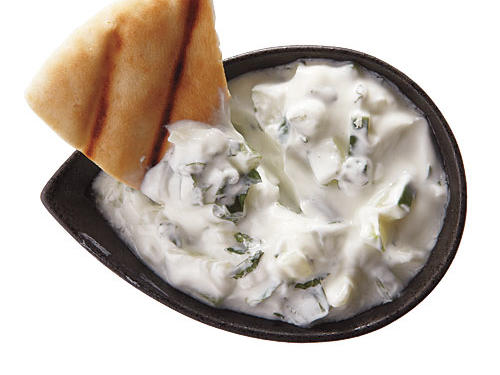 Greek-style basic tzatziki: combine 1 cup plain low-fat Greek-style yogurt, ¾ cup finely chopped seeded cucumber, 1 tablespoon chopped mint, 1/8 teaspoon salt, and 1/8 teaspoon white pepper. Cover, chill, serve.