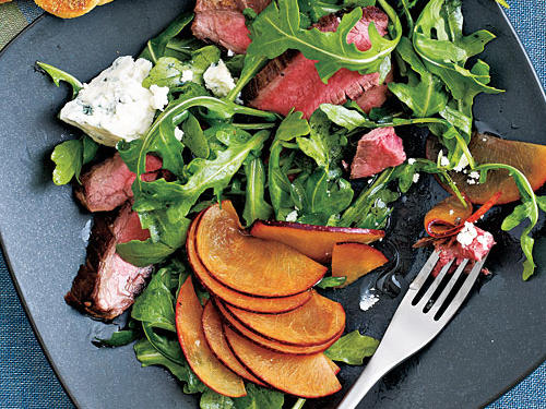 Combine the comforting flavors of steak and cheese with fresh summer greens and fruit for a filling salad that's less than 300 calories.