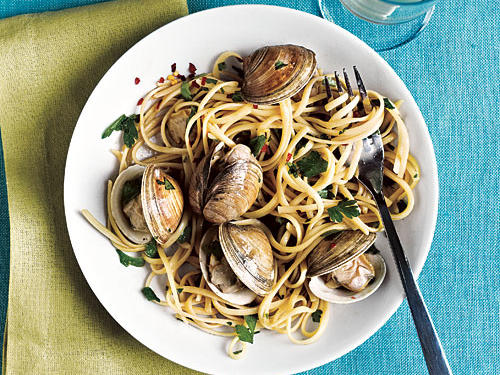 Linguine with clams make the perfect pair—it must be something about the pleasing contrast between the long, flat noodles, and the round, fat morsels of shellfish.