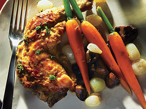 Don't limit your pressure cooker to stewing tough cuts of beef, pork, or lamb: You can prepare elegant entrées, too, like this chicken with a rich sauce and vegetables. For the best textured vegetables in this dish, allow the carrots, onions, and mushrooms to come to pressure, and then immediately take them off heat and release pressure.
