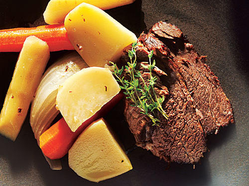 "A classic pot roast is the ""gateway"" recipe to using your pressure cooker—it's quick, and you're rewarded with a hearty dish in a fraction of the time. Use the Pressure-Cooker Beef Stock (seen on next slide) here, or substitute 1 (14-ounce) can of fat-free, lower-sodium beef broth plus 1 1/2 cups water in its place. (You'll add about 50 milligrams sodium to each serving with this switch.)"