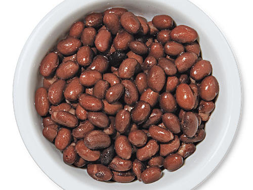 Among legumes, black beans hold the prize as richest source of soluble fiber; each cup provides nearly five grams of this potent cholesterol-lowering agent. In fact, beans may hold the record for most soluble fiber among the whole plant kingdom; a 1/2 cup of cooked black beans carries nearly twice the soluble fiber of oats. Early studies in animals suggest that most of this soluble fiber is concentrated in the inner part of the bean (not the skin).How much is good? Start with 1/2 cup per day and work up to a cup of black beans or any kind of bean to make the biggest impact on cholesterol.See More: Dried Bean Recipes