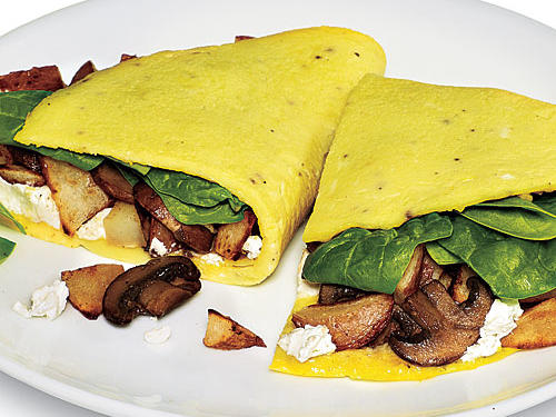 Overflowing with potato, goat cheese, spinach, and mushrooms, the textures of this hearty garden omelet will leave you wanting more.