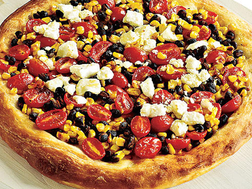 Is there anything more prosaic than frozen corn? But when it's given a zing from the paprika, combined with other toppings like cherry tomatoes and black beans, and all laid onto supermarket pizza dough: voilà, Tex-Mex Confetti Pizza, a crowd-pleaser.