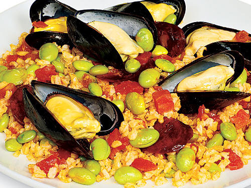 "Yes, it's possible to riff on the flavors of Spain's most famous dish and make a delicious Quick Paella. ""It's amazing how a dish with so few ingredients has such big, smoky flavor,"" says Associate Food Editor Tim Cebula."