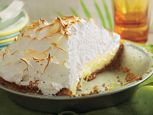 The origin of the Key Lime Pie is obscure and disputed, but not the likely reason it came to be: Little refrigeration in the hot, remote Florida Keys meant a pie made from canned, sweetened condensed milk (invented in the middle of the 19th century) was a sensible thing. Add the juice of tart little local limes to balance the ferocious sweetness of the milk, and you have a wonderful pie. The graham cracker crust probably came later, but it sure is convenient. Even in its namesake area, there is no single recipe for Key Lime Pie. In Key West restaurants and homes, different crusts, meringues, and filling techniques abound.