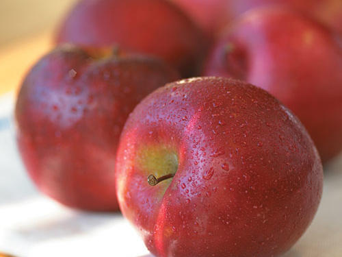 """Over the last few decades many reports suggest that polyphenols, antioxidant compounds found in apples and apple juice, may help inhibit the oxidation of LDL or """"bad"""" cholesterol. Oxidation of LDL cholesterol is what leads to plaque buildup in arteries. Apples are also a good source of soluble fiber and have roughly the same cholesterol-lowering abilities as oats. If you're counting, one small apple harbors one gram of soluble fiber. Don't like apples? Many fruits sport comparable levels: 1/2 medium grapefruit, 1/2 large pear, 3 prunes, 2 dried figs, and one cup of strawberries.How much is good? Dare we say """"an apple a day"""" is a good place to start. Better yet, maybe the new mantra should be an apple at every meal.See More: Healthy Apple Recipes"""