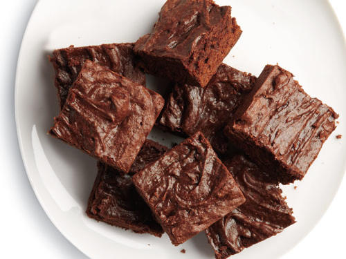 We give you fudgy, decadent brownies at half-the-calories. We replaced the typical ton of butter with a combo of low-fat baking tricks. Two kinds of chocolate—cocoa and melted dark chocolate—add deep chocolate flavor.