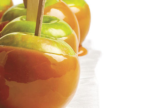 Gooey homemade caramel may take a little time, but it's totally worth the effort. Kids and adults alike love this sweet-tart buttery snack. Click through the following slides to learn how to make caramel apples in your own kitchen.