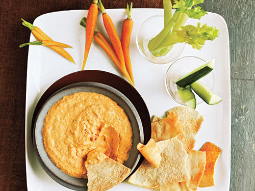 Stash a protein-packed dip like Greek yogurt or peanut butter in the office fridge or your desk drawer for those days when you just don't have time for breakfast. The combination of fiber-filled veggies and satiating dips will help you stay away from the break room pastry platter. Here are three quick-dipping ideas:1. Pack peanut butter in a small container then dip with a mix of celery sticks, cucumbers, and apple slices.2. Mix plain Greek yogurt with a drizzle of honey as a dip with carrots and whole-grain pretzel sticks.3. Hummus can be a wonderful dip for sliced fruit and veggies anytime of the day.4. Try your hand at making your own dip, like this savory recipe.