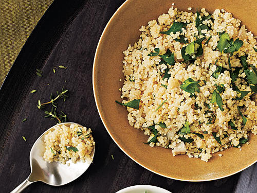 Chopped shallots and fresh thyme and parsley come together with quick-cooking couscous for a versatile, no-fuss side dish.