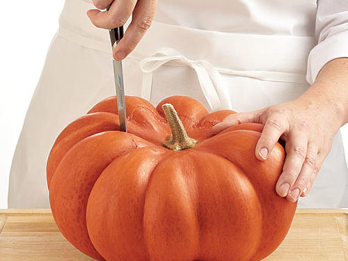3. First, select a good one. Look for a deep, rich, uniform color—no green or light tan spot where it rested on the ground—and a healthy, stiff stem. Avoid any pumpkin with soft spots. Farmers' markets will usually yield the freshest options.4. Then prep it. Keep clicking for cooking ideas.Step 1: Place pumpkin on a steady surface, stem side up. Use a small knife to cut around the stem, about 2 inches out.
