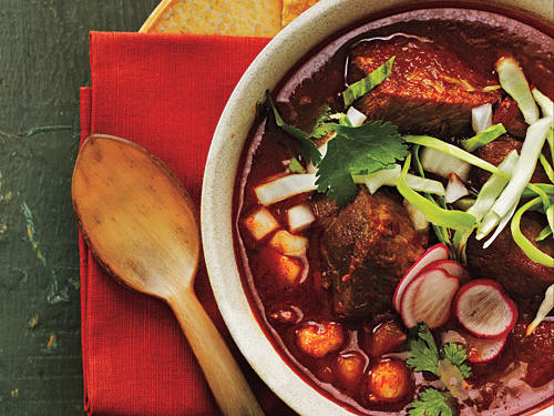 Chiles flavor this soup and melt into the tender pork. Serve with lime wedges, chopped onion, cilantro leaves, and sliced radish and cabbage.