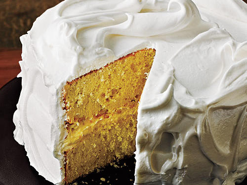 Light and fluffy meringue frosting tops layers of moist vanilla cake making this a delicious and beautiful end to any meal.