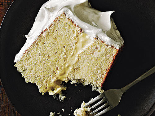 "Light and fluffy meringue frosting tops layers of moist vanilla cake making this a delicious and beautiful end to any meal. Associate Food Editor Julianna Grimes raves, ""It's such an impressive-looking cake, and it tastes as good as (or better than) it looks."""