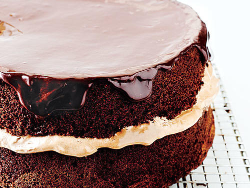 We love the classic flavor combination in this light, moist layer cake. Instead of a full frosting, simply spoon a warm chocolaty glaze over the two layers.