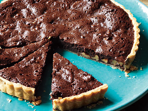 A riff on the classic pecan pie, this dessert is rich, chocolaty, and a little fancier with its freestanding fluted sides. Of course, you can use a 9-inch pie plate if you don't have a tart pan with a removable bottom.