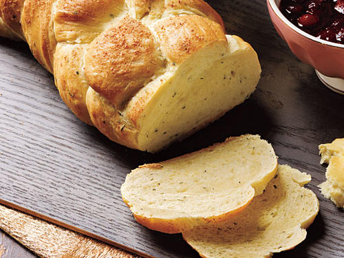 The traditional yeasted egg bread is enriched even more by adding cheese to the dough. We love the flavor of fontina, but Gruyère or another Swiss cheese would also work.