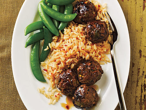 Serve these garlicky, spicy meatballs with steamed sugar snap peas and two cups cooked rice tossed with 1 tablespoon chile paste—you'll find it on the ethnic aisle of most supermarkets or at Asian grocers.