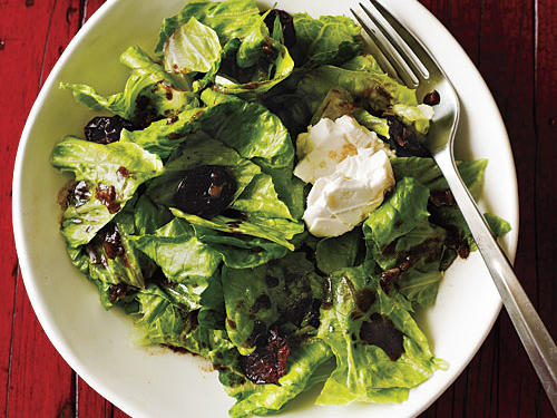 Tart cherries, sharp feta, and crisp romaine blend together nicely for this classic hors d'oeuvre. Customize this basic salad by using other fruit, such as dried cranberries, apricots, or raisins. Try blue or goat cheese for variation.