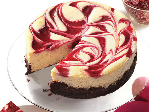 A simple swirl on top of the cheesecake gives this holiday dessert an elegant touch. (Learn How to Make a Swirl Cheesecake). If the cranberry mixture gets too thick, add a tablespoon of water and whirl it around in the food processor. You can also make this in an 8-inch springform pan; it'll be very full, so you should cook over a foil-lined baking sheet. Cook time will be the same.
